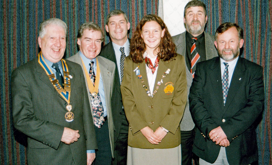 Youth Exchange Scholar Alice Nugent pictured with Wilfred Young, Brendan Conway, Michael Mullan, DG Alistair Laird and Ricky Butler in 1998 (from l:r).